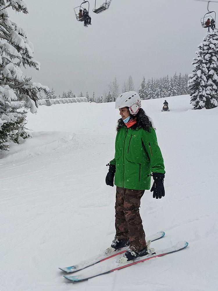 A beginner skiers slides down a green run on Whistler Mountain.
