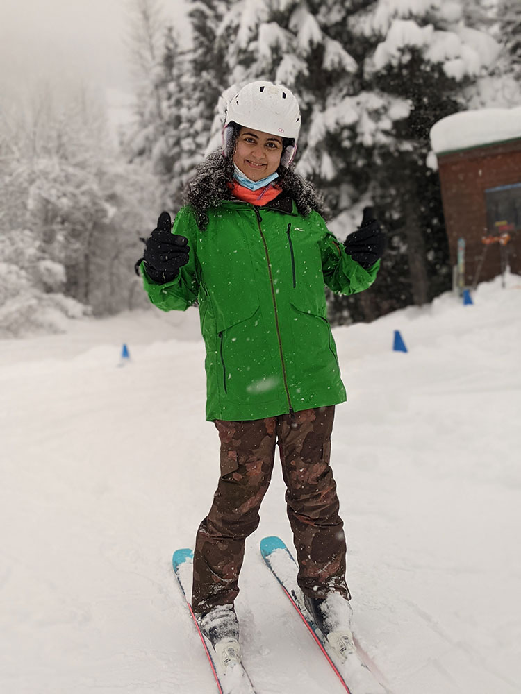 A skier gives the camera the thumbs up while on a beginner lesson on Whistler Mountain.