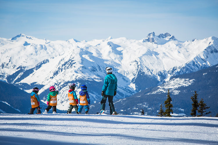 Kids on a ski school lesson in Whistler.