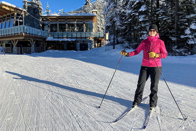 Kylie Wilkins stands on her cross-country skis outside of the lodge at Whistler Olympic Park.