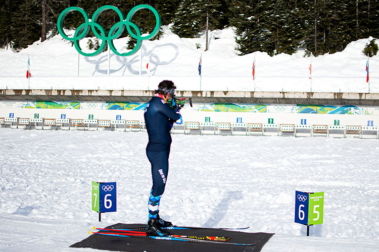One of the biathlon pros takes a shot at the target from standing at Whistler Olympic Park.