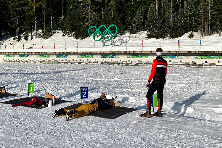 Amber lies prone on her belly taking a shot at the target at Whistler Olympic Park.