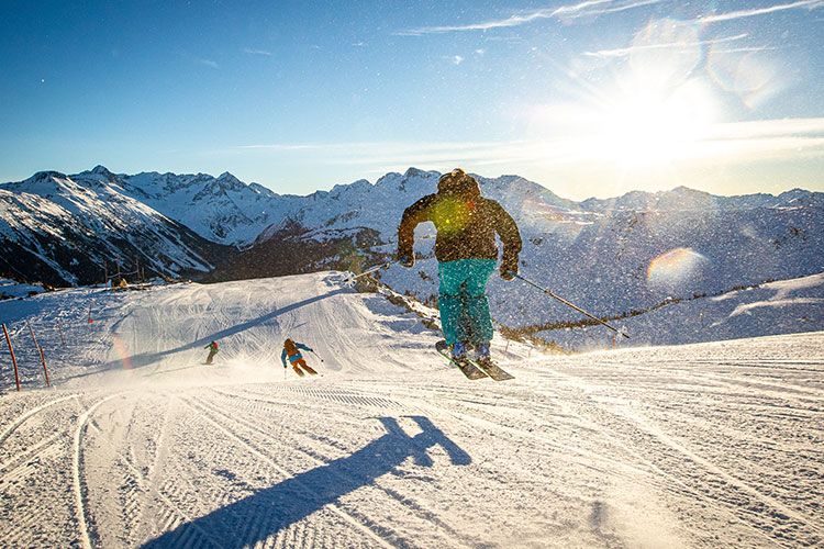 A group of skiers enjoy the fresh corduroy in Whistler.