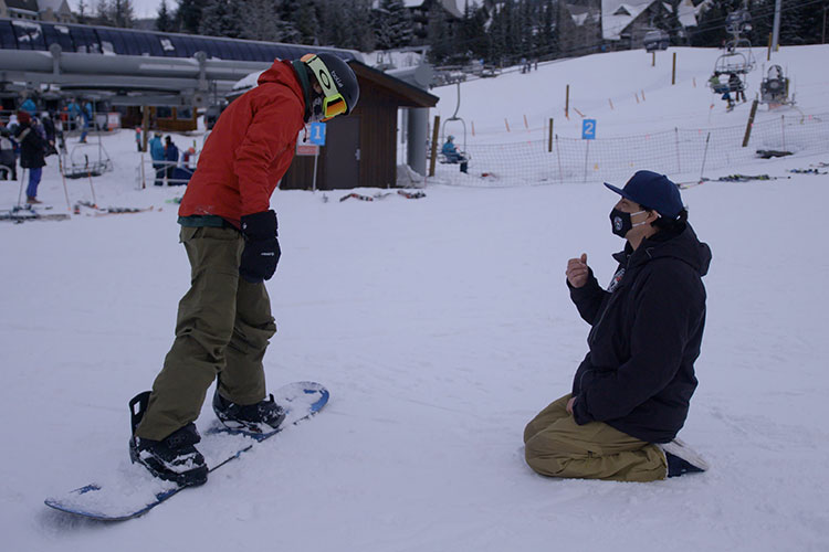 Court Larabee coaches a young snowboarder at the base of Blackcomb Mountain in Whistler.