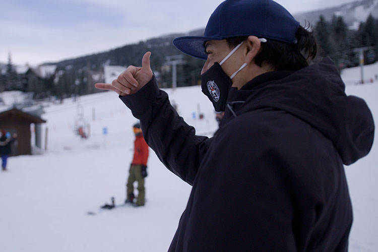 Court Larabee does the rock on hand symbol to his snowboarding students.