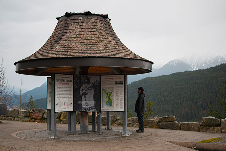 A man reads the information boards along Highway 99 on his way to Whistler.