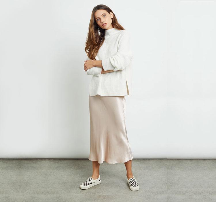 A woman models the Berlin Midi Skirt.