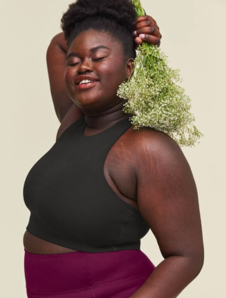 A woman models the Dylan Bra from Girlfriend Collective.
