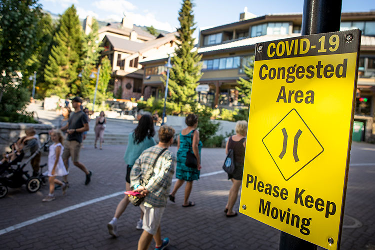 A COVID-19 congested area sign on the stroll in Whistler Village.