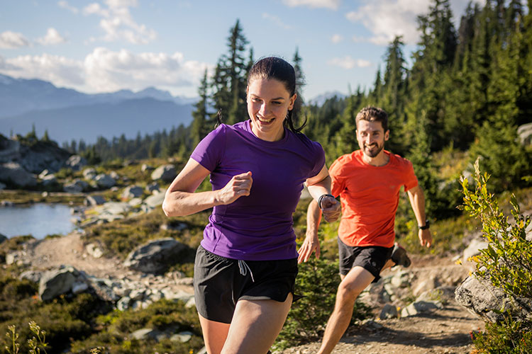 Two runners are in the high alpine in Whistler.