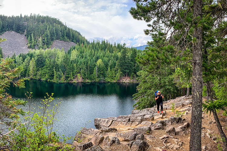 A woman hikes around Loggers Lake in Whistler.