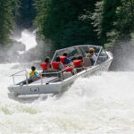 People ride through white water rapids with Whistler Jet Boating.