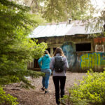 Two women find an old cabin at the Parkhurst site in Whistler.