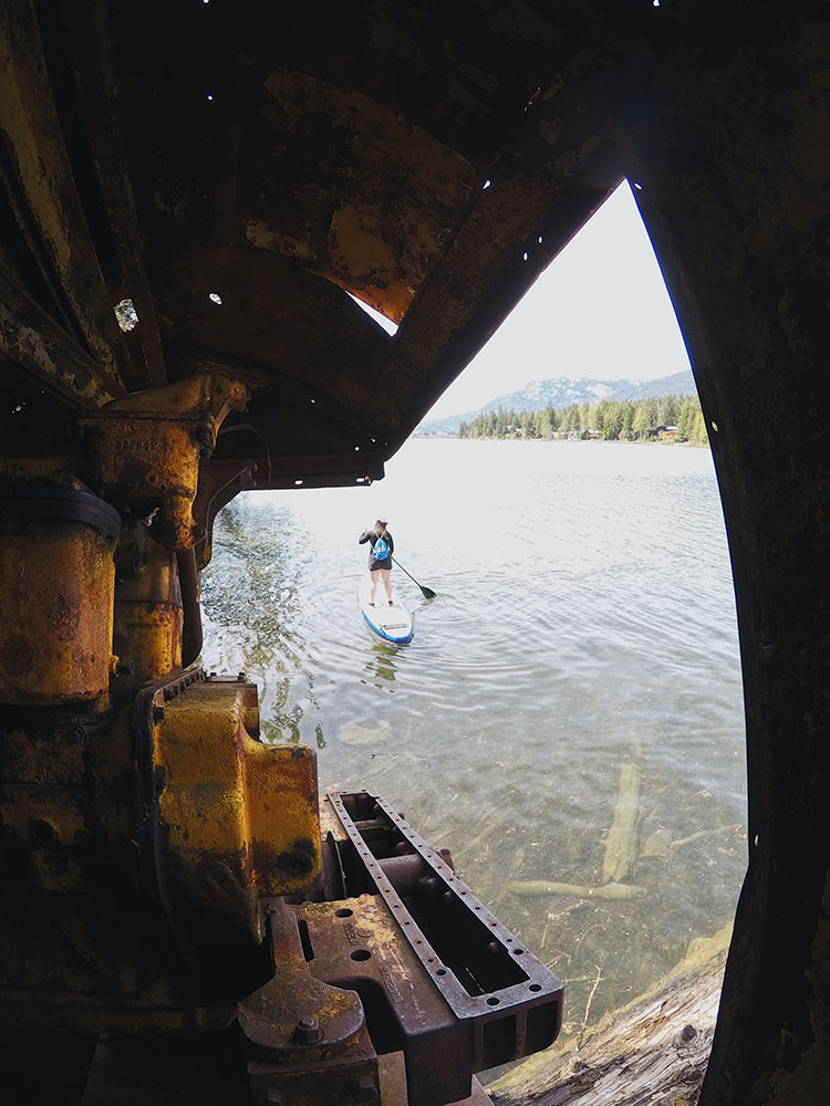 A paddle boarder comes to Parkhurst from Green Lake.