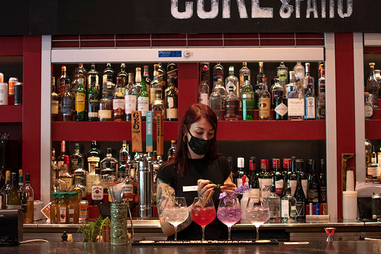 A bartender prepares cocktails at the bar at the Cure Lounge in Whistler.