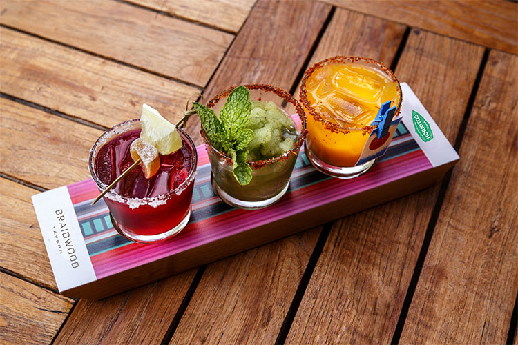 Three colourful margaritas sit in a line, part of the Margarita Flight at the Four Seasons Whistler.