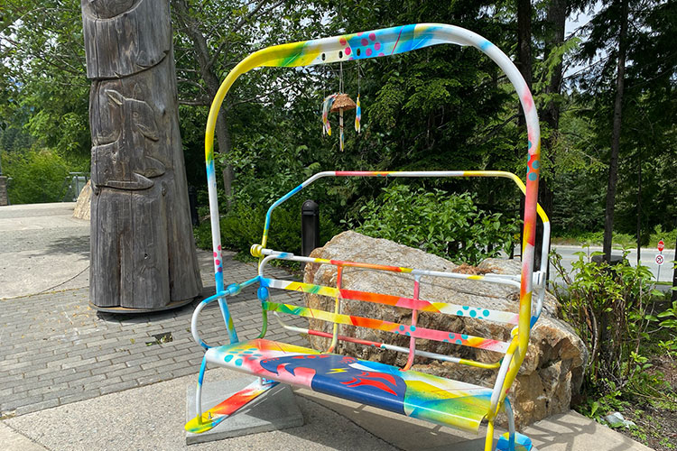 An old Catskinner chair lift from Whistler Blackcomb given a revamp by a local artist.