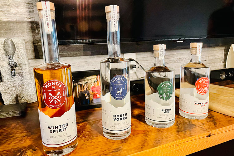 The Winter Spirit, North Vodka, Alpine Gin and Alpenglow Gin lined up.