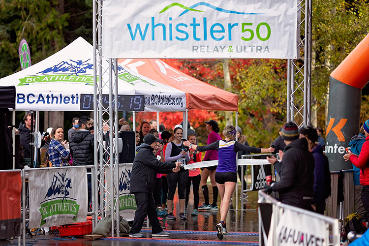 Runners crossing the line at the Whistler 50 Relay and Ultra.