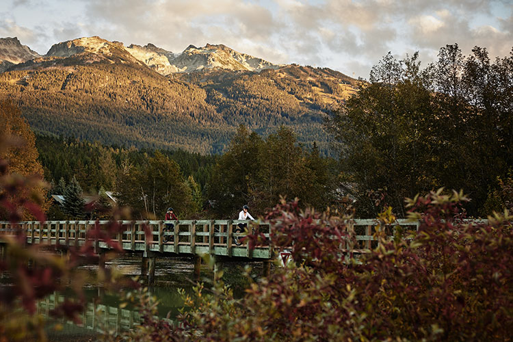 Bikers explore the Whistler Valley Trail in the fall.