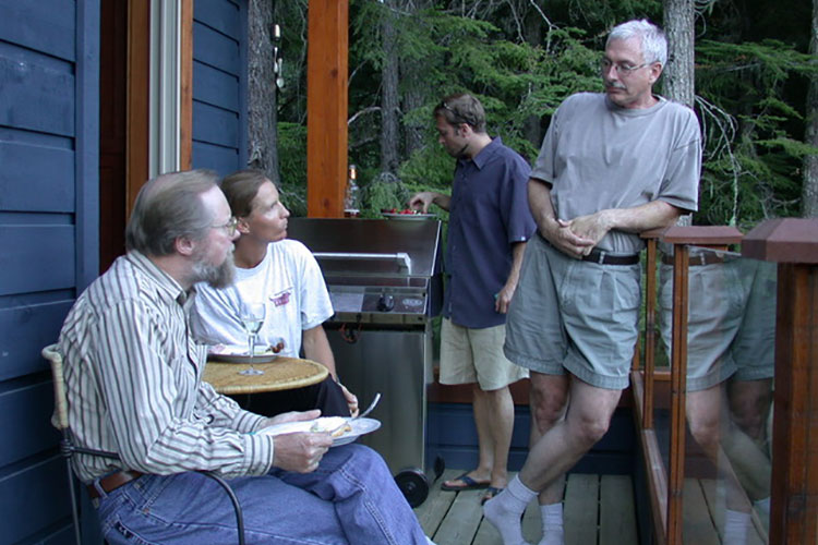 A group of writers talk on the deck of a house at the first Whistler Writers Festival.