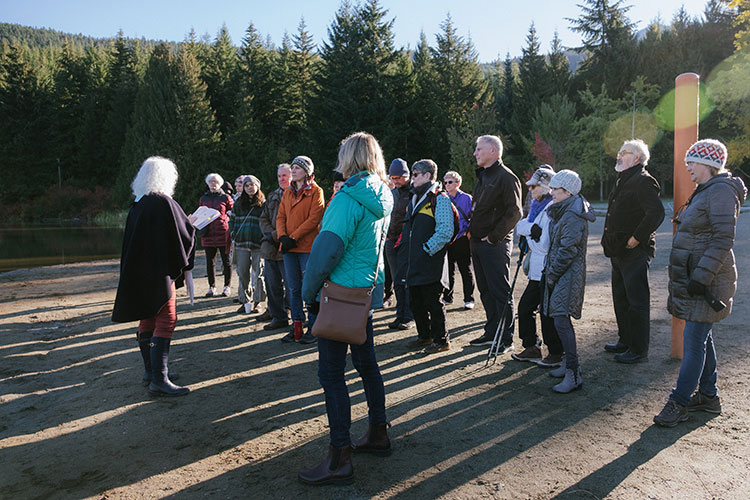 A group of writers and readers gather at Lost Lake for a Whistler Writers Festival event.