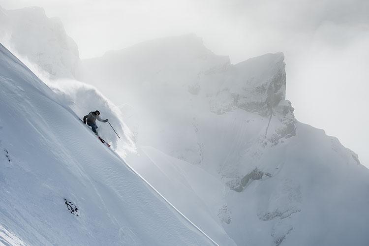 A skier tackles steep, powdery terrain on Whistler Blackcomb.