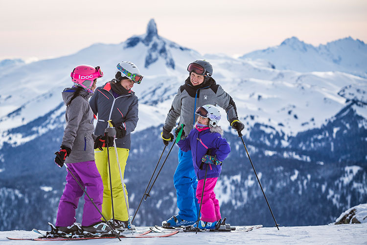 A family chat at the top of a ski run on Whistler Blackcomb.