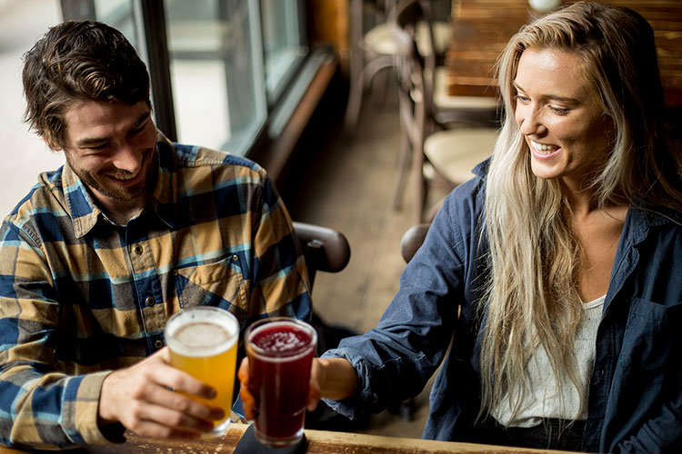 A couple drink craft beer in Whistler.
