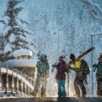 A group of skiers walk away from the Creekside Gondola in Whistler.