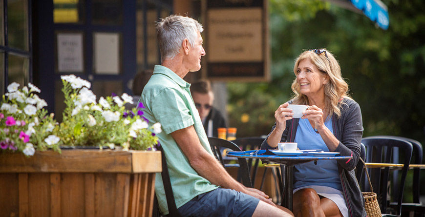 Two people dining on a patio in Whistler BC