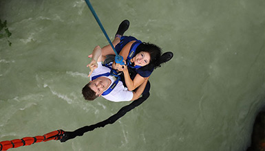 Couple bungee jumping over the Cheakamus River in Whistler BC