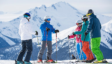 Skiers taking a ski lesson at Whistler Blackcomb