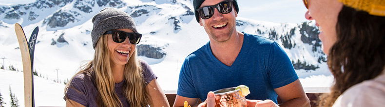 Enjoying a sunny, mountaintop patio at the end of winter on Whistler Blackcomb