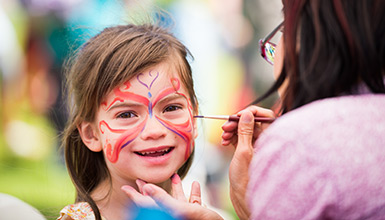 Happy child getting her face painted at Whistler Children's Art Festival