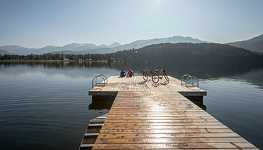 People sitting on the dock at Alta Lake in Whistler BC