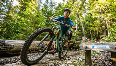 Person riding Lost Lake Trails in Whistler BC
