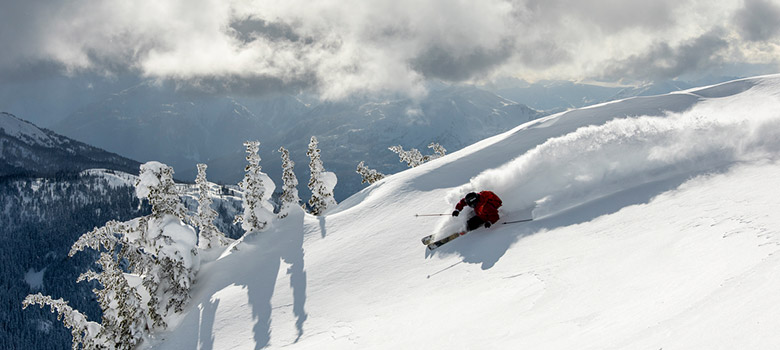 Skier carving a big turn at Whistler Blackcomb