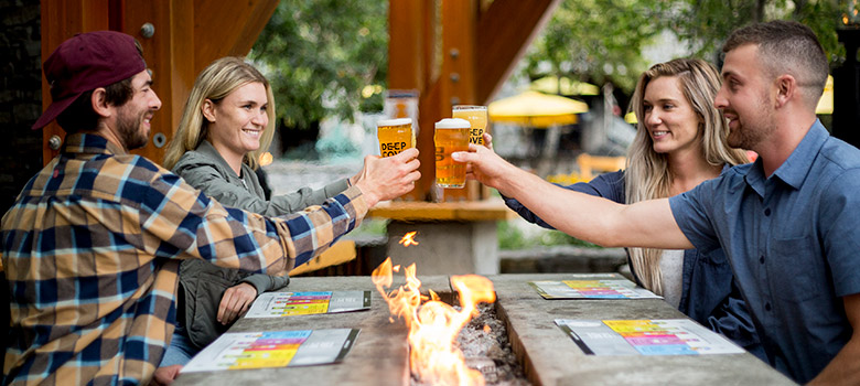 People enjoying craft beer on a patio in Whistler