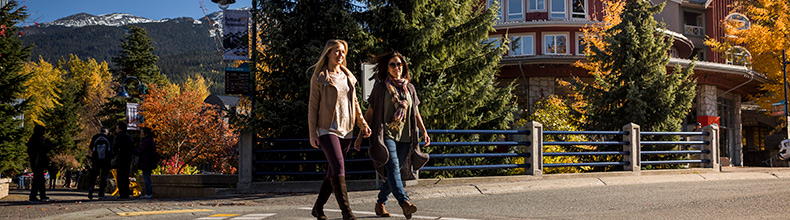 Two women walking in the Village in Whistler, BC