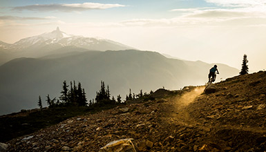 Riding an alpine trail on Whistler Mountain