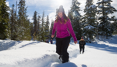 Two women snowshoeing in Whistler