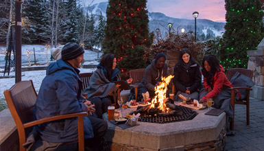 People dining on a patio in Whistler in Winter