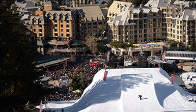 Snowboarder competing in Big Air at WSSF in Whistler BC