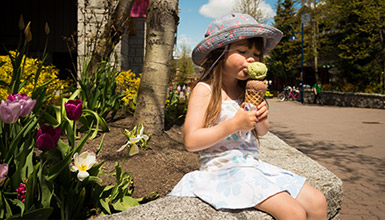 Little girl enjoying an ice cream cone in Whistler