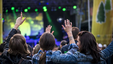 Spectators enjoying an outdoor concert at GO Fest in Whistler BC