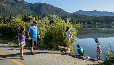 Family walking along Valley Trail at Green Lake in Whistler