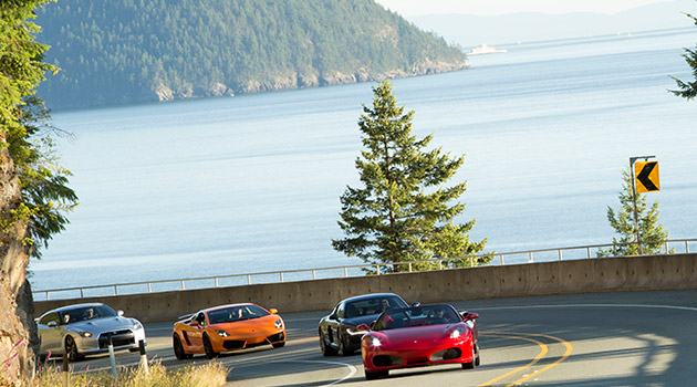 A fleet of exotic cars on Highway 99 on the way to Whistler, BC