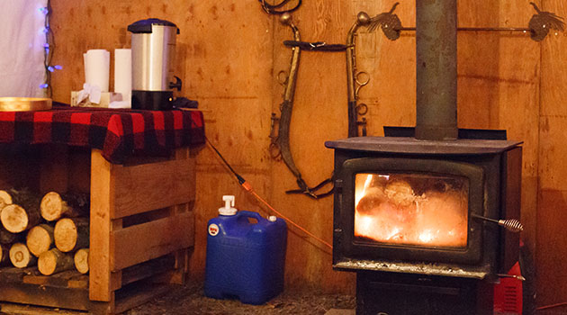 Stop at a cozy cabin and enjoy a cup of hot chocolate