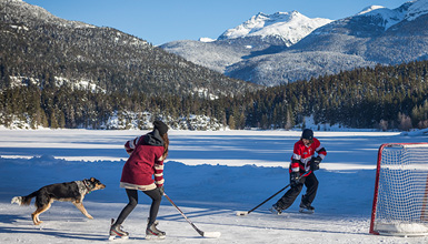 Playing hockey on a frozen lake in Whistler